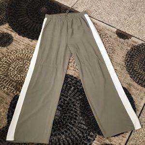 Women's wide leg draped pants.